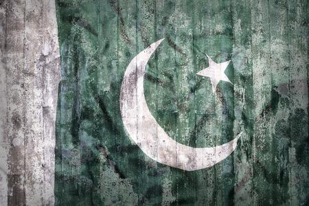 pakistani pakistan: Grunge style of Pakistan flag on a brick wall for background Stock Photo
