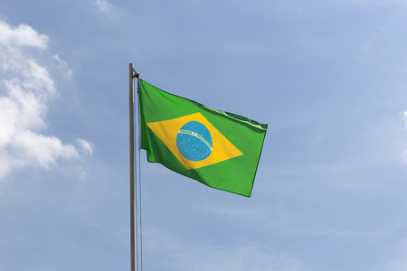 flagpole: National flag of Brazil on a flagpole in front of blue sky
