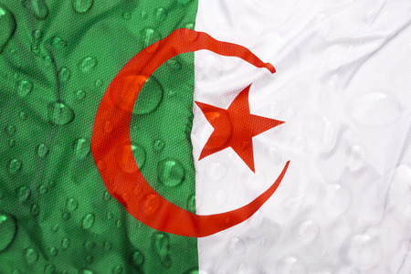 Textile flag of Algeria with rain drops Stock Photo