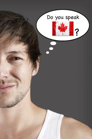 Handsome student, do you speak Canadian? Banco de Imagens