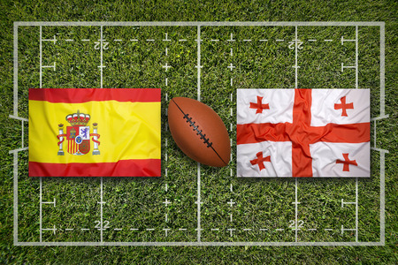 Spain vs. Georgia flags on rugby field