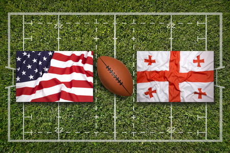 USA vs. Georgia flags on green rugby field