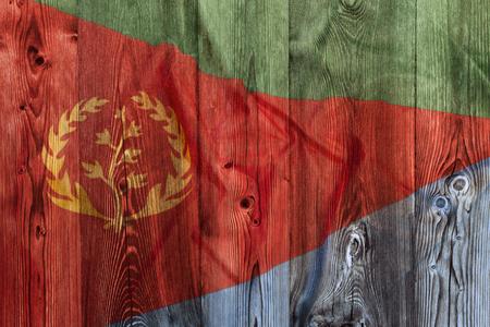 National flag of Eritrea on wooden background