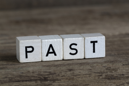 Past, written in cubes on a wooden background Stock Photo