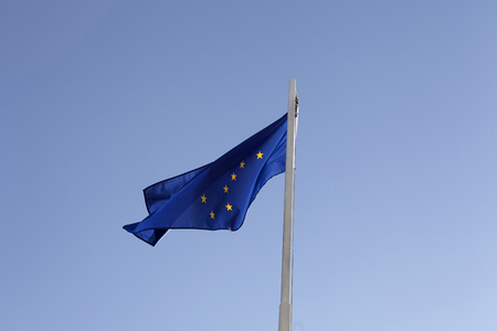 National flag of Alaska on a flagpole in front of blue sky Stock fotó - 77267067