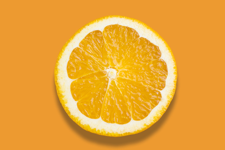 Slice of Orange on a colorful background Stock Photo