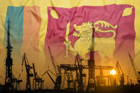 Industrial concept with Sri Lanka flag at sunset, silhouette of container harbor