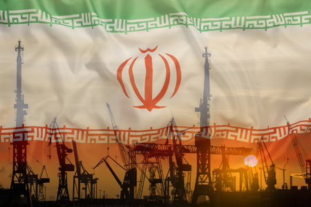 Industrial concept with Iran flag at sunset, silhouette of container harbor