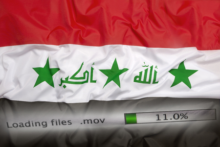 personally: Downloading files on a computer with Iraq flag Stock Photo