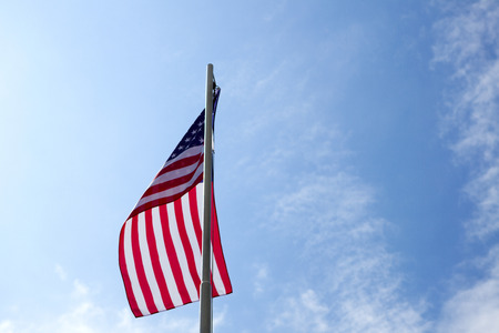 Flag of United States on a flagpole in front of blue sky Stock fotó - 93761014