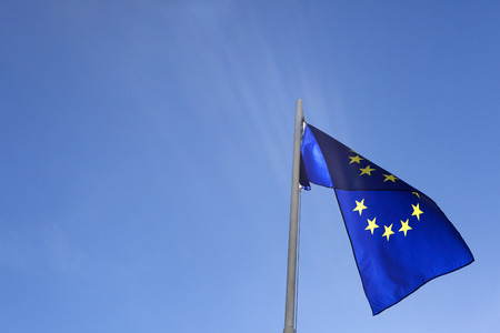 Flag of European Union on a flagpole in front of blue sky Stock fotó - 93752940