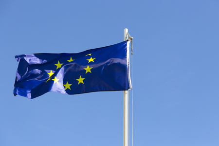 Flag of European Union on a flagpole in front of blue sky Stock fotó - 93761045