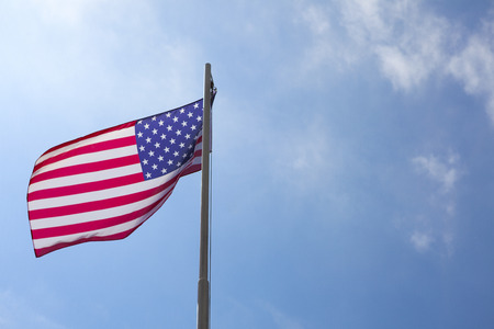 Flag of United States on a flagpole in front of blue sky Stock fotó - 93761052