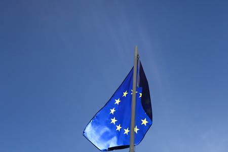 Flag of European Union on a flagpole in front of blue sky Stock fotó - 93752986