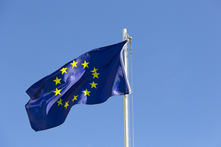 Flag of European Union on a flagpole in front of blue sky Stock fotó - 93752989