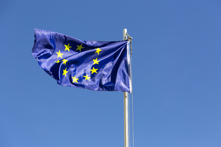 Flag of European Union on a flagpole in front of blue sky Stock fotó - 93753100