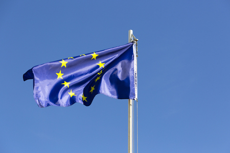 Flag of European Union on a flagpole in front of blue sky Stock fotó - 93753113