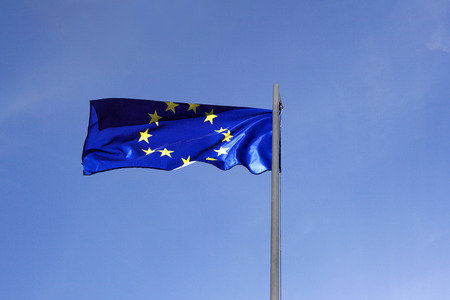 Flag of European Union on a flagpole in front of blue sky Stock fotó - 93753114