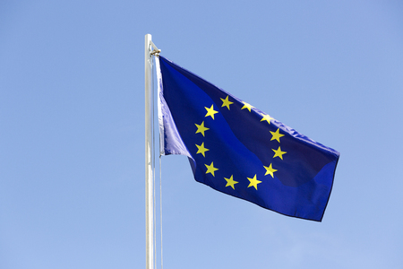 Flag of European Union on a flagpole in front of blue sky Stock fotó - 93753199