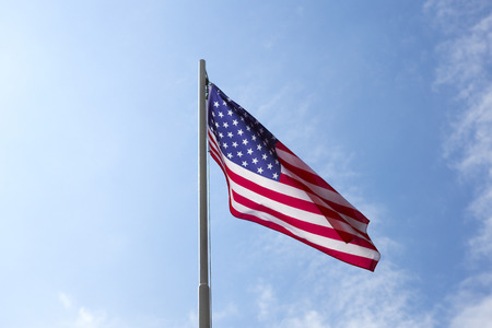 Flag of United States on a flagpole in front of blue sky Stock fotó