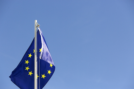Flag of European Union on a flagpole in front of blue sky Stock fotó - 93753411