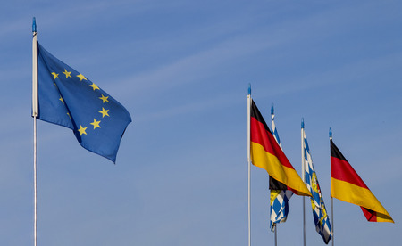 European flag with Germany and Bavarian flags in front of blue sky Stockfoto