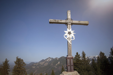 Summit cross of mountain Heuberg, Bavaria, springtime Stock Photo