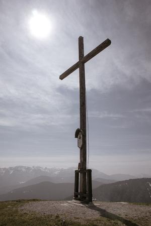 Summit cross on mountain Heiglkopf in Bavaria, Germany