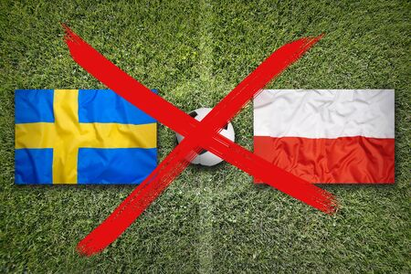 Canceled soccer game, Sweden vs. Poland flags on green soccer field 免版税图像 - 142130293