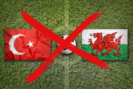 Canceled soccer game, Turkey vs. Wales flags on green soccer field