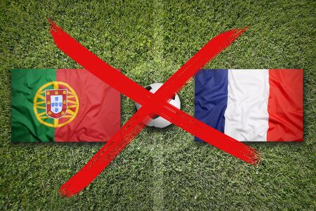 Canceled soccer game, Portugal vs. France flags on a green soccer field