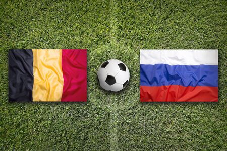 Belgium vs. Russia flags on a green soccer field