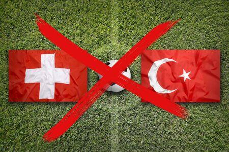 Canceled soccer game, Switzerland vs. Turkey flags on green soccer field