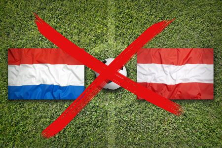 Canceled soccer game, Netherlands vs. Austria flags on green soccer field