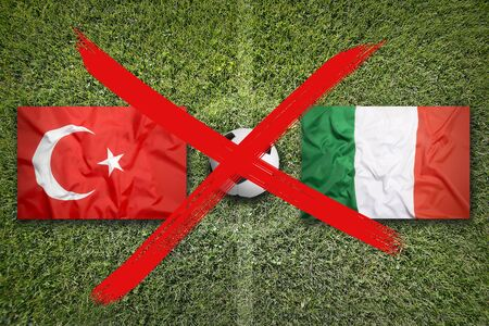Canceled soccer game, Turkey vs. Italy flags on green soccer field