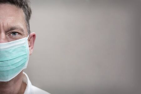 Portrait of a caucasian man in medical mask. Coronavirus concept, respiratory protection