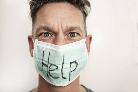 Portrait of a caucasian man in medical mask with stop text. Coronavirus concept, protection Stock Photo