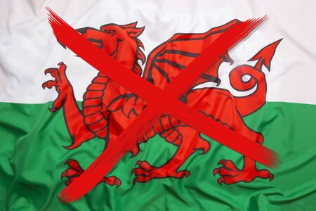 Red crossed out flag of Wales, curfew concept