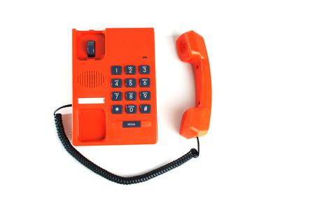 Orange colored telephone on white background