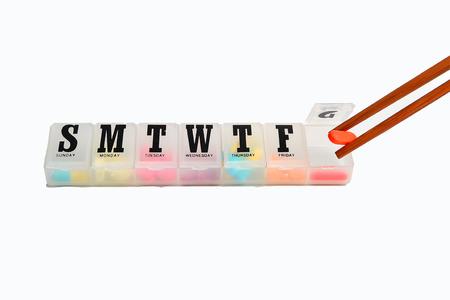 Medicine organizer and pills on white background 스톡 콘텐츠