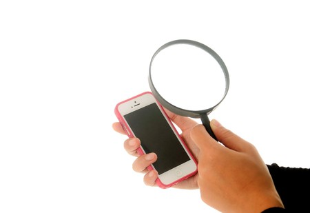 Hand holding magnifying glass of data security 스톡 콘텐츠