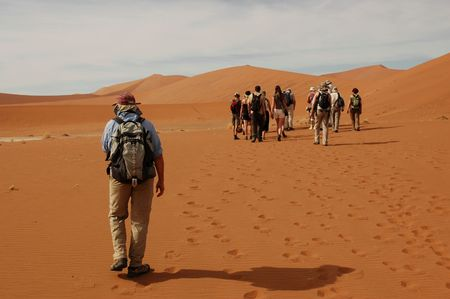 lagging: Desert group with man behind Stock Photo