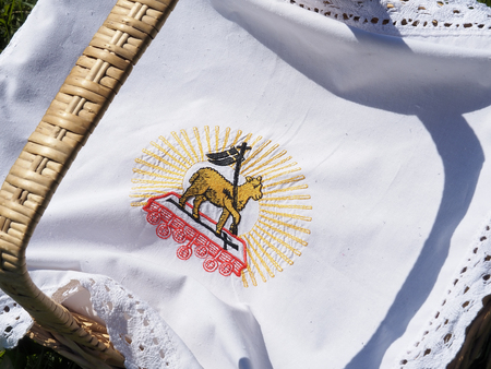 Close up of embroidered cloth with a traditional european Easter theme. Imagens