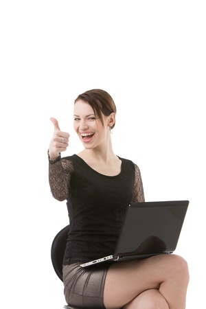 Woman with laptop giving thumb up photo