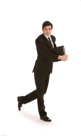 stride: Attractive young businessman in a suit walking with a folder in his hand, full length mid stride studio portrait on white