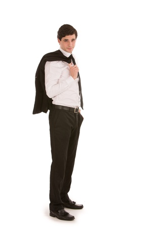 shirtsleeves: Handsome young businessman with his jacket over his shoulder standing sideways looking at the camera isolated on white Stock Photo