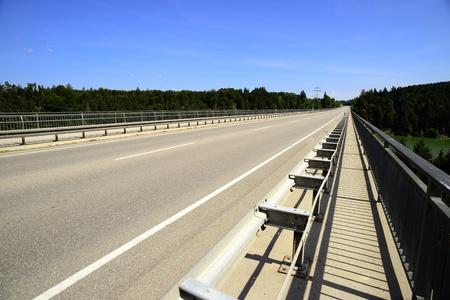 Concrete road bridge over the river called