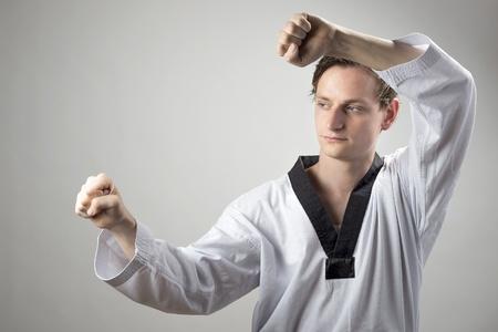 Taekwon-Do black belt champion is doing a defense block Stock Photo