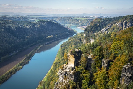 View from viewpoint of Bastei in Saxon Switzerland Germany to the town Wehlen and the river Elbe on a sunny day in autumn photo
