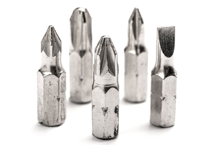 Used screwdriver bits on white background Stock Photo - 15909908